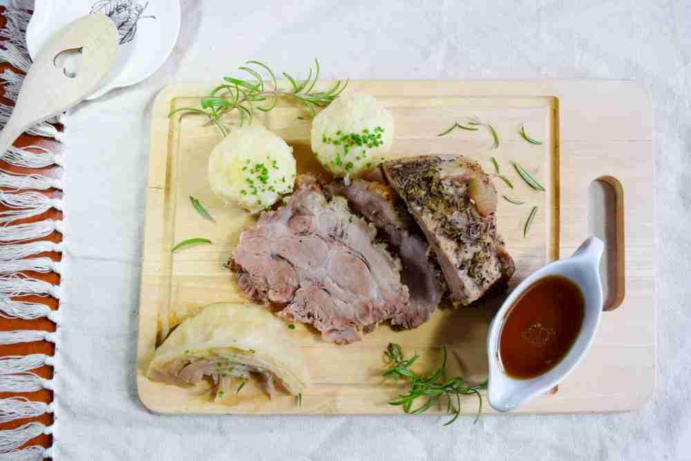 Roast pork with bread dumplings and sauerkraut in Vienna in Austria